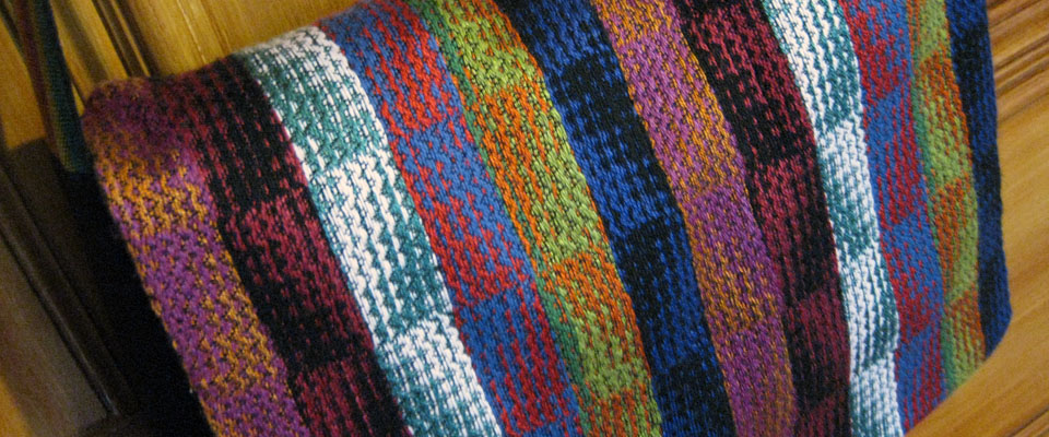multicoloured echo weave messenger bag
