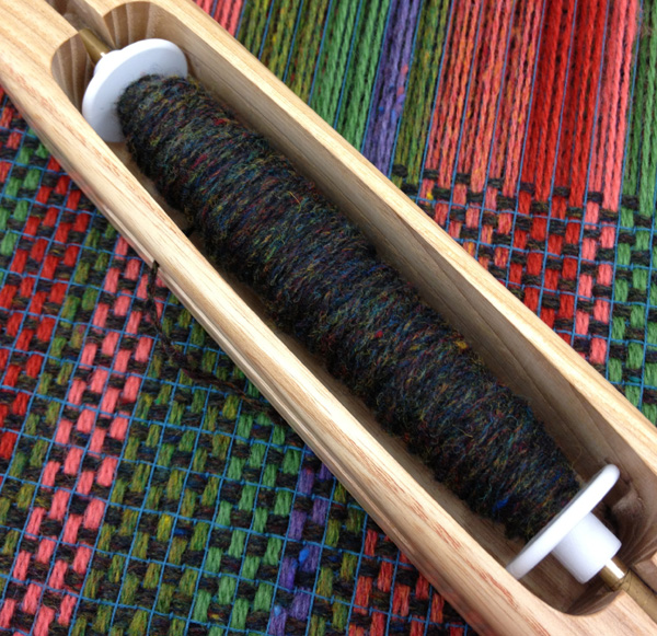 wool on loom with darker weft