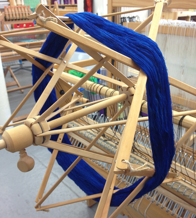 blue yarn on swift