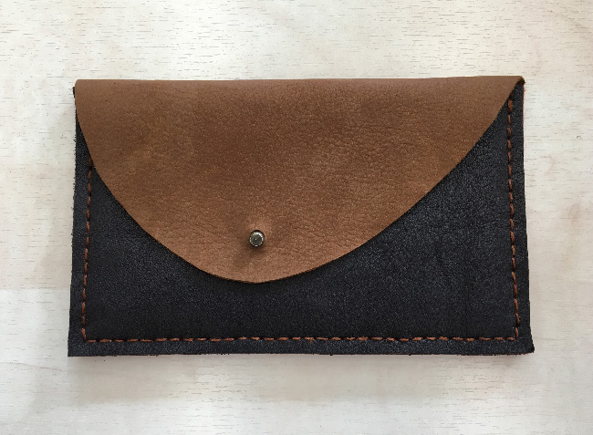 first leather purse